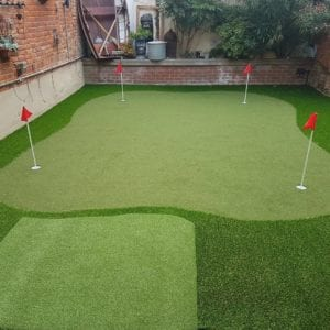 Putting green and tee mat home installation
