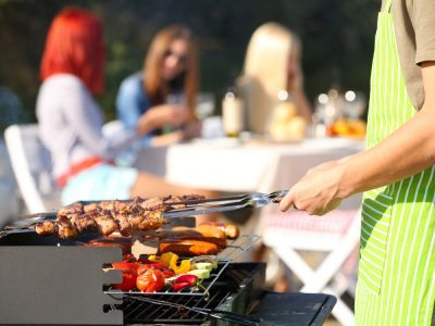 Hosting a barbecue in a garden with artificial grass