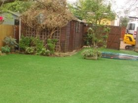 Installation of fake lawn with sheds