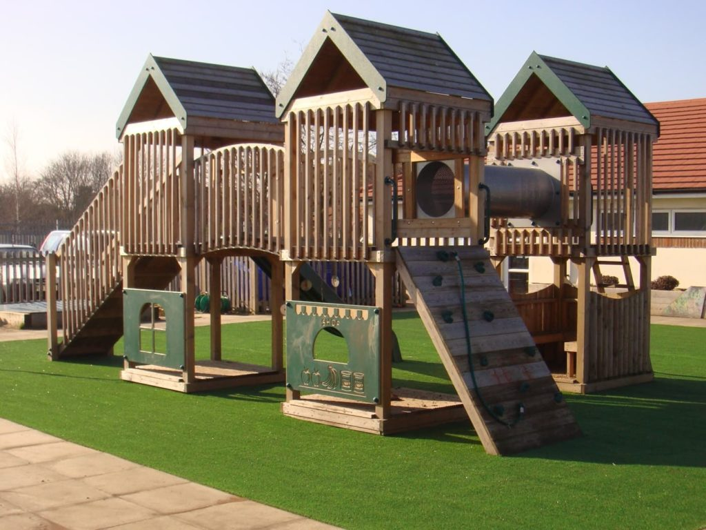 Play equipment on artificial grass